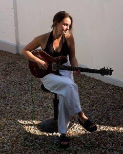 Freya Roy Playing Guitar